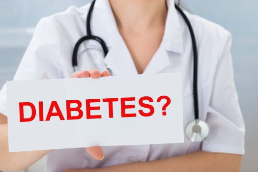 Doctor Holding Placard With Diabetes Text